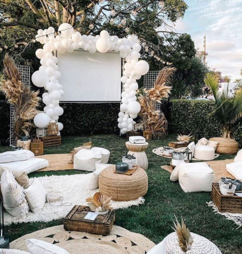 garden party ideas outdoor cinema with balloons and blankets