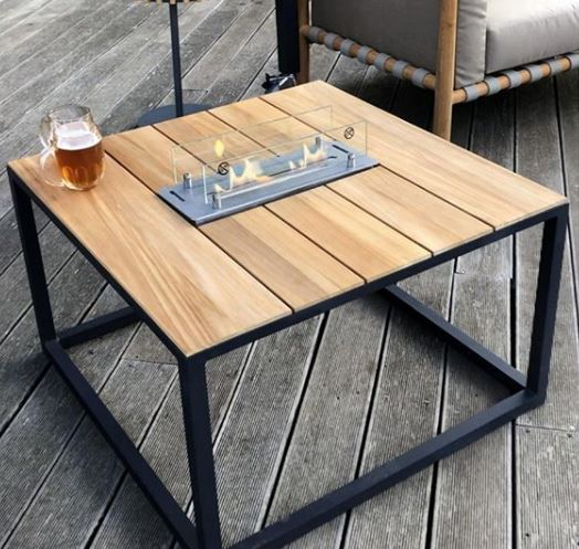 a modern industrial style fire pit table