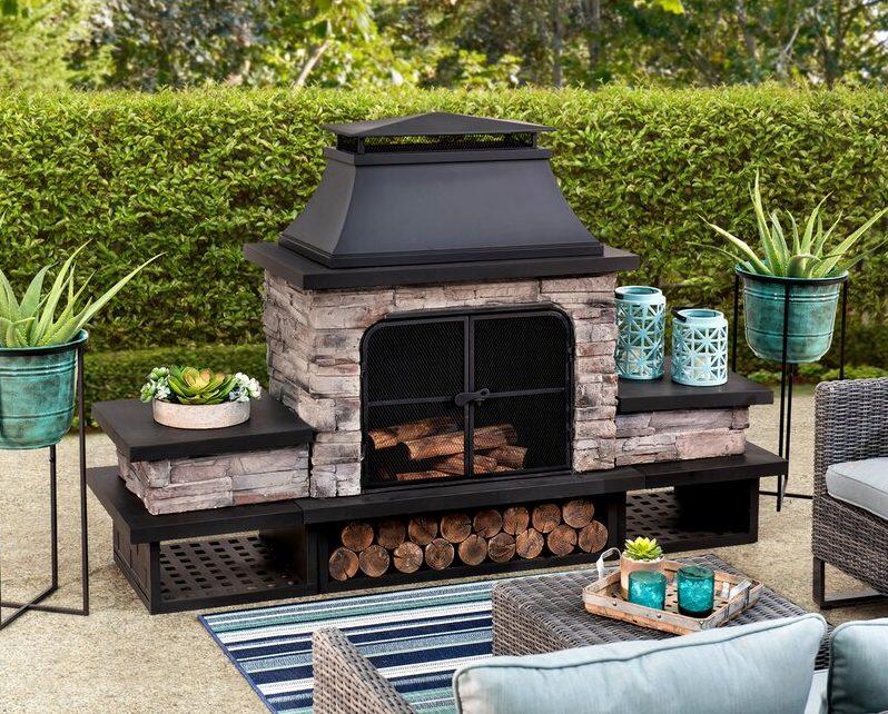 an elaborate freestanding outdoor fireplace