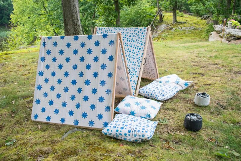 two child-sized outdoor shelters with hand-printed fabric