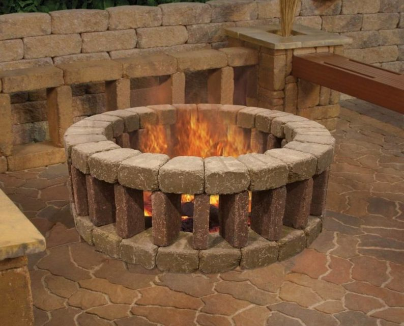 a circular fire pit made from bricks stacked in a pattern