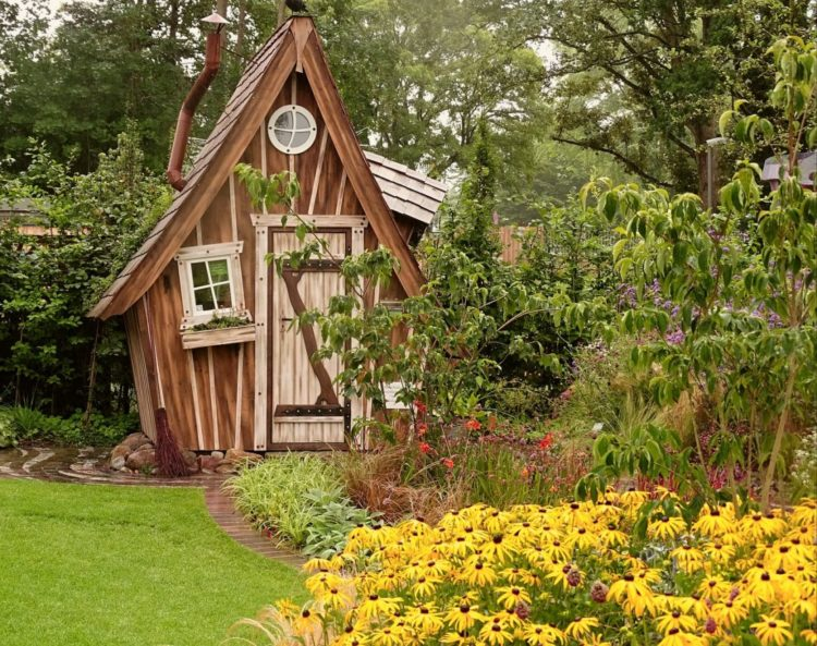 a whimsical, crooked-looking shed that could be from a storybook