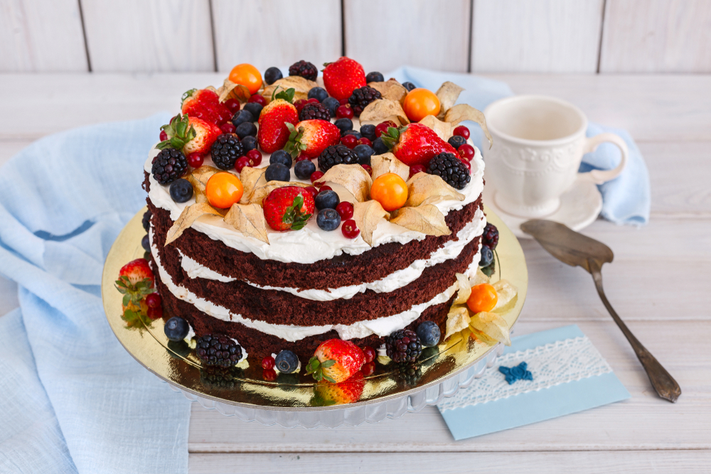 delicious garden party ideas for food include naked cakes topped with fresh berries