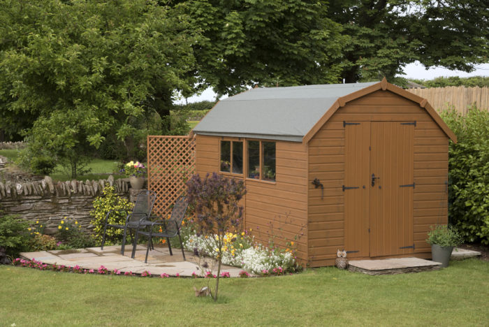 a large brown garden shed with double doors