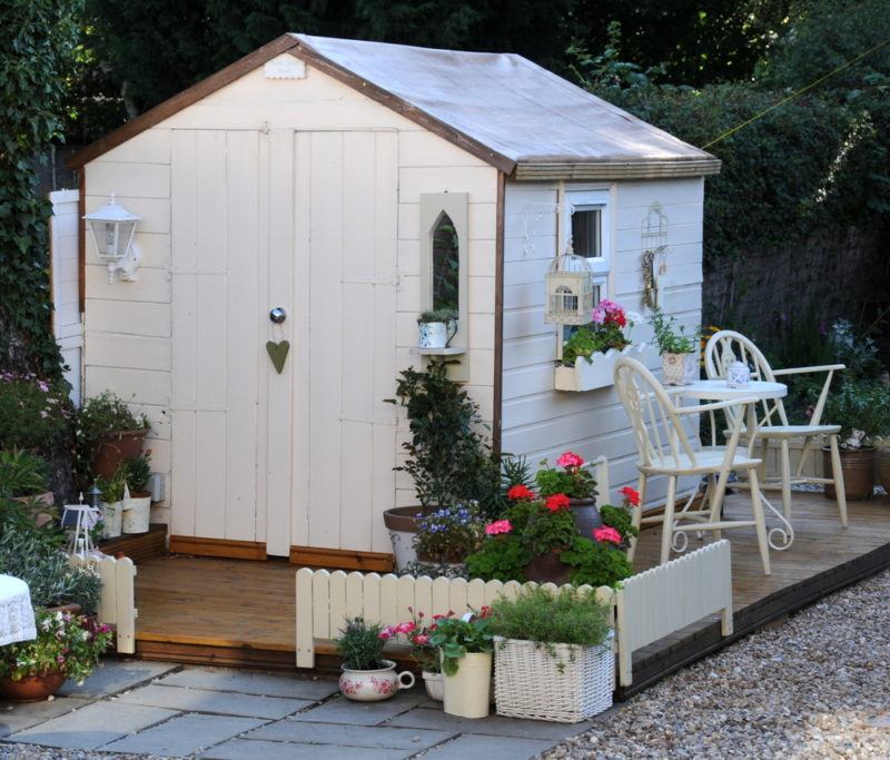 garden shed ideas that match the colour of your shed with fencing, patio furniture and plant pots
