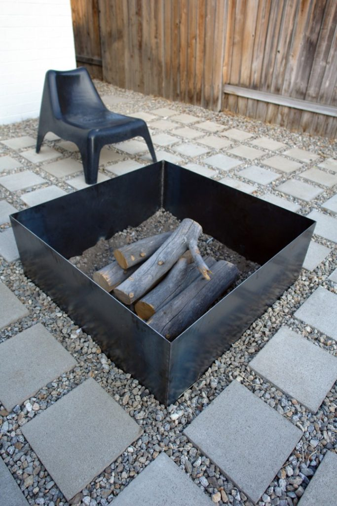 a DIY square metal fire pit on a patio