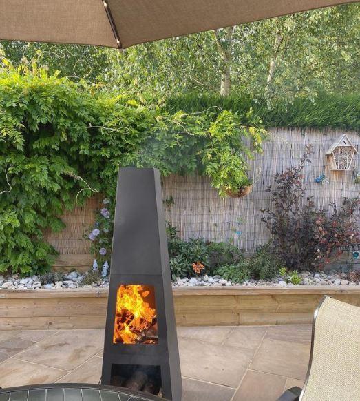 a modern chiminea on a patio