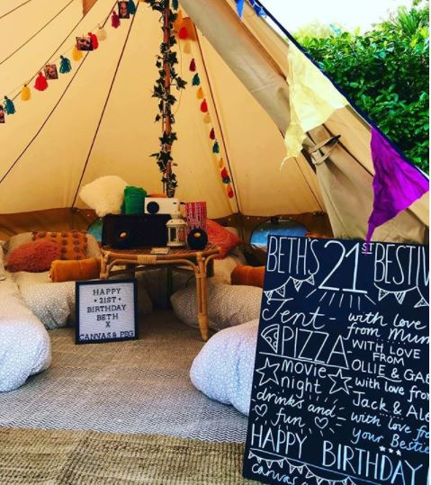 garden camping ideas with festival tent decorated with bright fabrics and fun signage