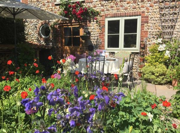 cottage garden ideas styled with lots and lots of flowers