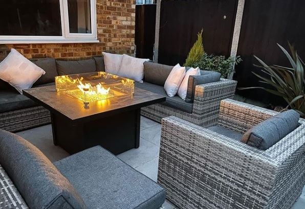 a gas fuelled ire pit style coffee table on a patio