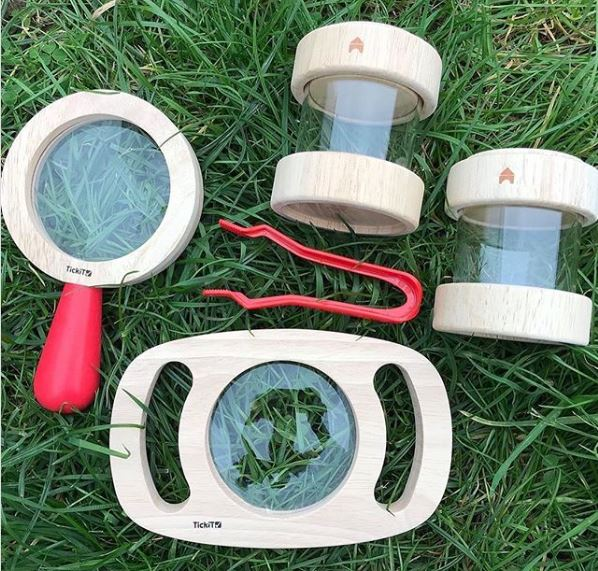 a child-sized kit for collecting bugs, including magnifiers and plastic canisters