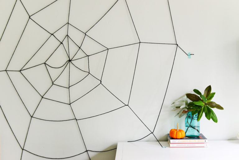 a DIY spiderweb made from string