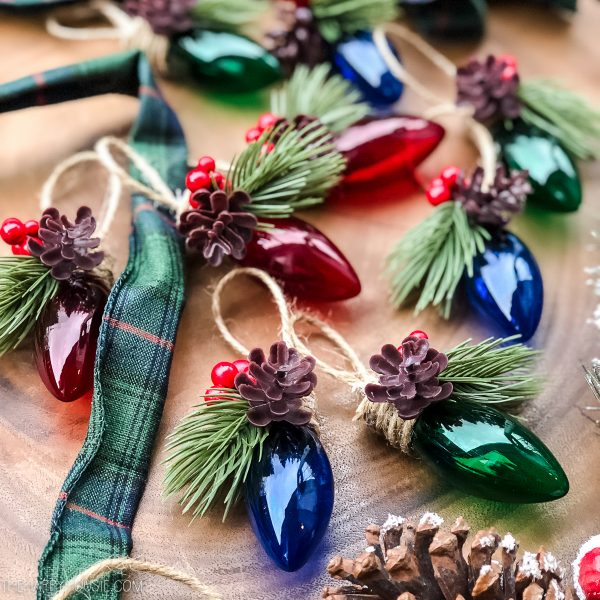 a string of vintage fairy lights with festive elements like pinecones and fir sprigs added
