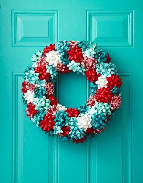 a jolly wreath made from white, red and turquoise gift ribbons