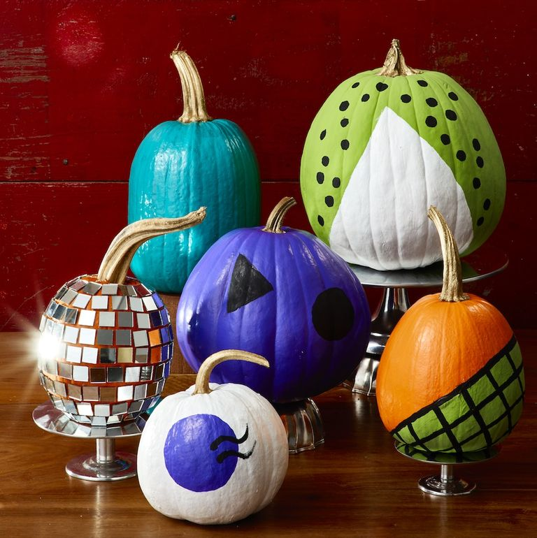 a collection of pumpkins painted in bright colours and patterns