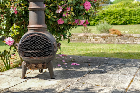 garden heating ideas with a traditional chiminea on a patio