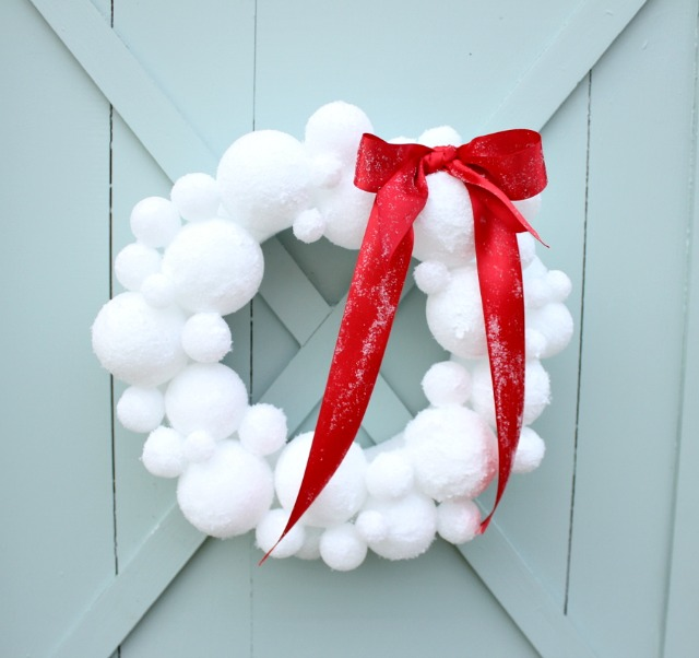 a wreath made from white spheres that look like snowballs