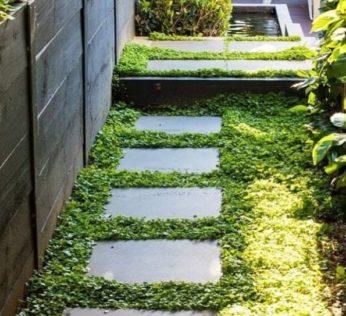 garden stepping stones nestled in a slightly overgrown floor coverage plant