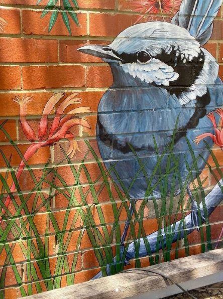 a close-up of a mural of a bird