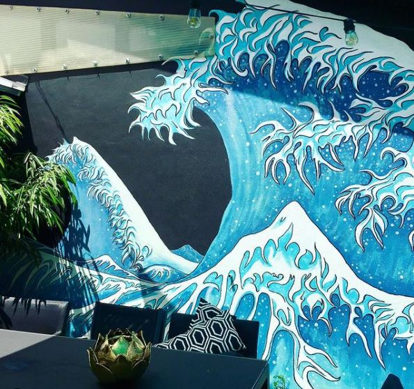 garden mural ideas of a huge, stylised wave, inspired by a Japanese artwork