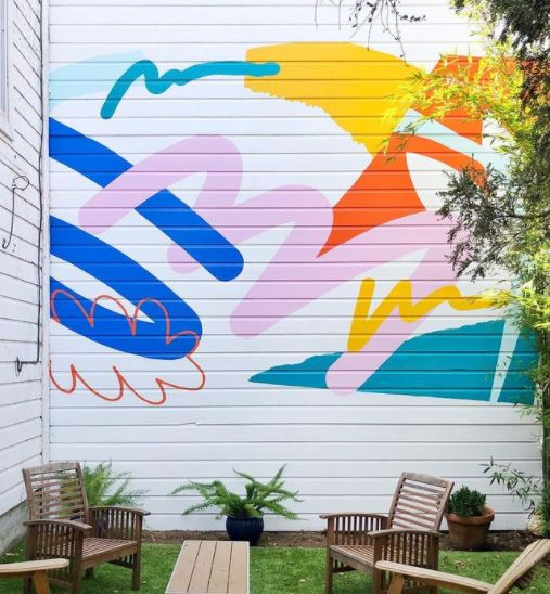 a bright garden wall mural using retro shapes and a cheerful colour palette