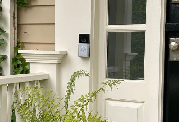 a front porch with a security camera doorbell