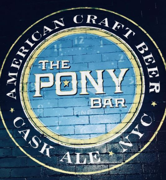 the logo for a bar painted onto a brick wall