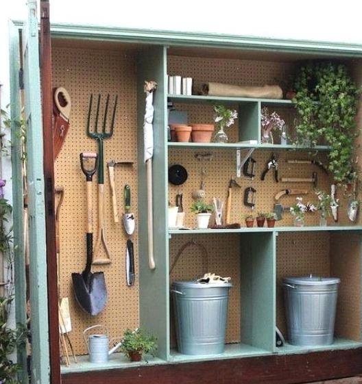 garden tool storage ideas using a peg board to create unique space for each item
