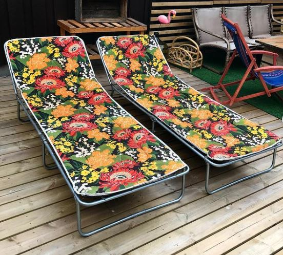 two retro sun loungers with a tropical flower print fabric