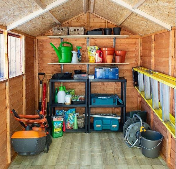 a tidy shed with organised shelves on the rear wall