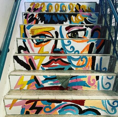steps with a stylised portrait painted going up the risers of each step