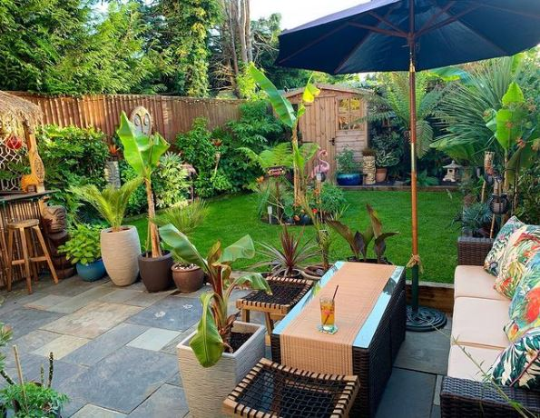 tiki garden ideas with lush plants and rustic furniture