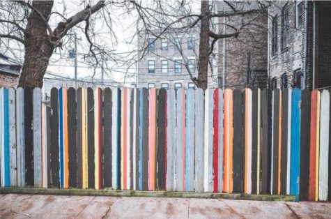 a fence where each slat is painted a different colour