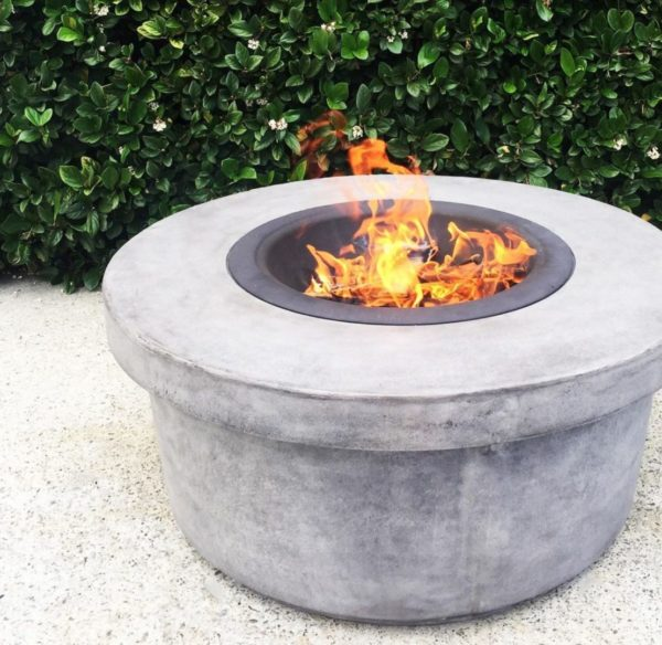 a circular fire pit made from concrete