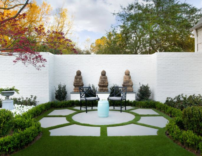 a patio made from irregular slabs that looks like a traditional sun dial or fountain surround