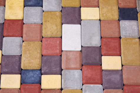 concrete blocks in all shades of red, yellow, grey, blue and purple