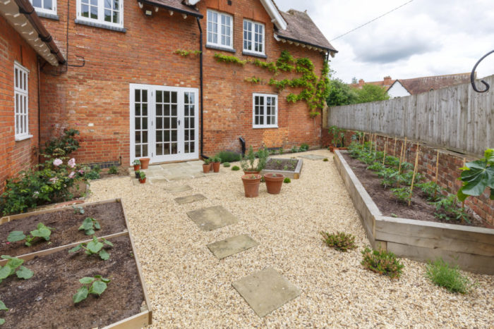 garden security ideas include covering the yard with gravel so visitors are noisy