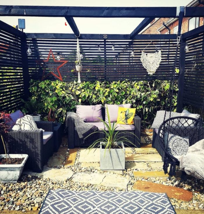 garden seating area with wooden pergola featuring screens for privacy and wind protection