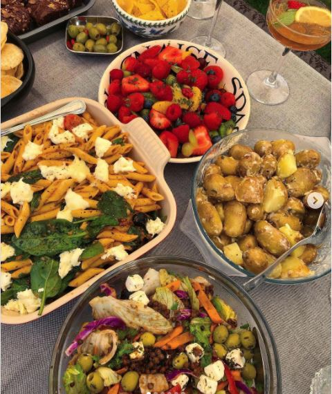 A table of delicious home-cooked food featuring garden vegetables