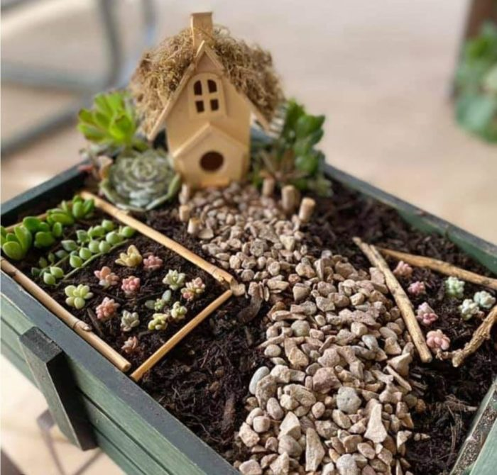 a small wooden crate used to contain a farm-themed fairy garden