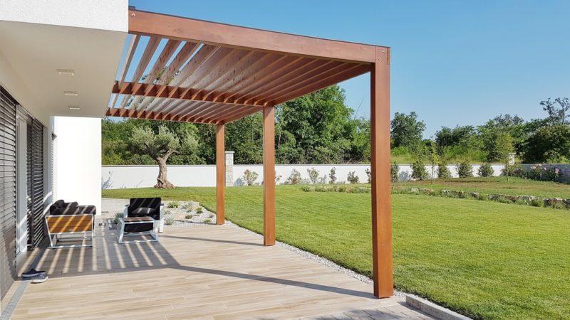 an ultra modern pergola standing over a clean, minimalist deck