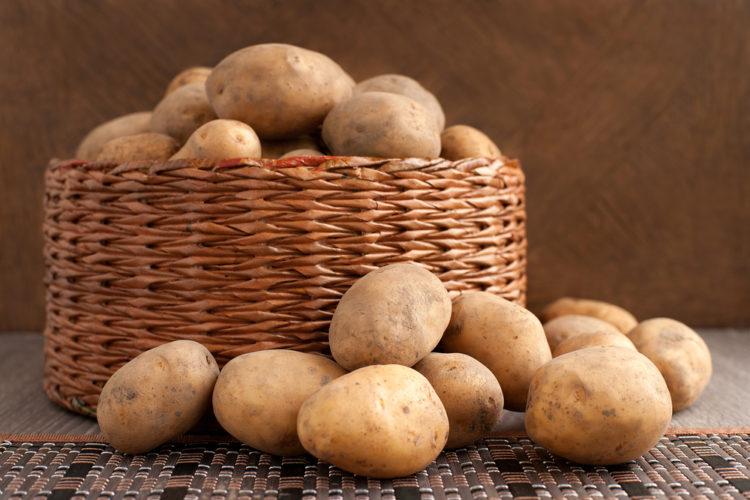a wicker basket brimming with potatoes