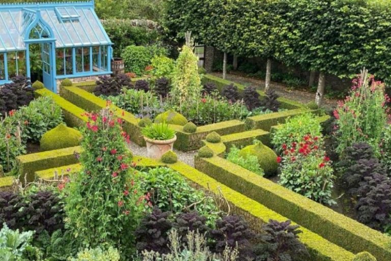 a beautiful, symmetrical kitchen garden with box hedge borders