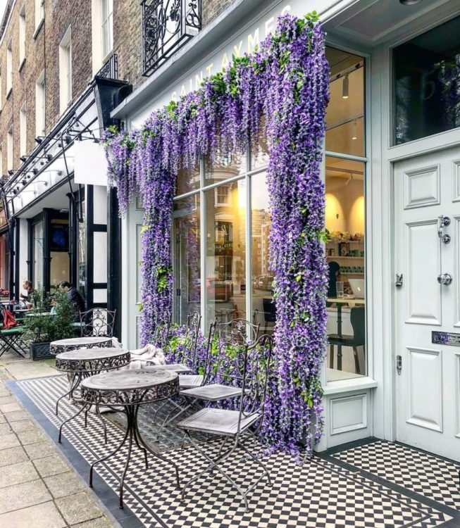 a chic cafe with wisteria framing the window