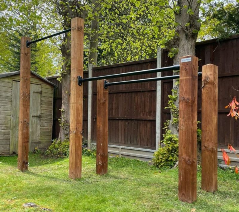 multi-purpose exercise bars installed in a garden gym