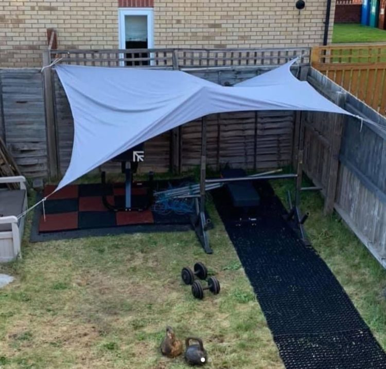 a tarpaulin covers an outside exercise area