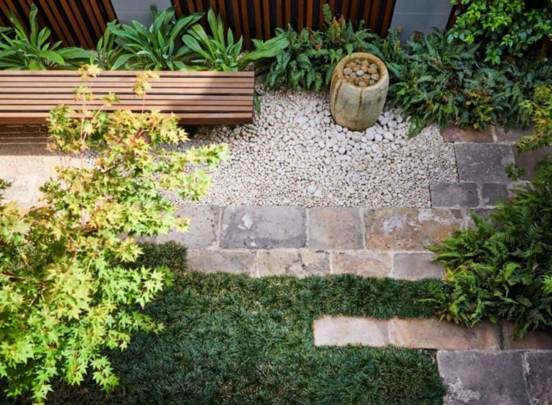 minimalist garden ideas can still have a grass area, hardscaped section and lots of plants, like this Japanese inspired space