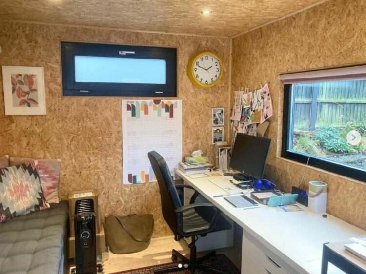 garden office interior ideas with bare chipboard used as a creative pinboard