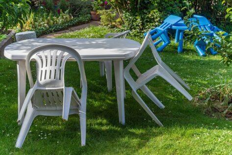 Plastic garden furniture on grass