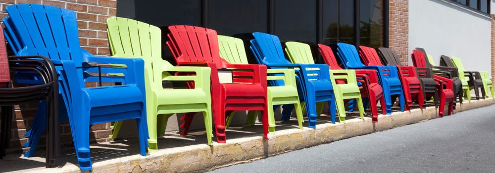 Colorful resin chairs in a row